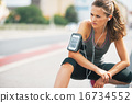 Portrait of fitness young woman outdoors in the city 16734552