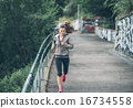 Fitness young woman jogging in the city park 16734558