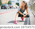 Portrait of fitness young woman outdoors in the city 16734573