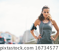 Portrait of fitness young woman in the city 16734577