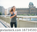 Fitness young woman jogging in the city 16734593