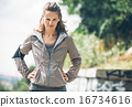 Portrait of fitness young woman in the city park 16734616