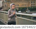 Fitness young woman jogging in rainy city 16734622