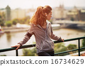 Portrait of fitness young woman in city in the evening 16734629