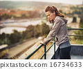 Fitness young woman looking into distance outdoors 16734633