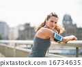 Portrait of fitness young woman in the city 16734635