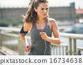 Fitness young woman jogging in the city 16734638