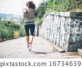 Fitness young woman jogging in the city park. rear view 16734639