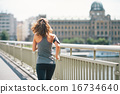 Fitness young woman jogging in the city. rear view 16734640