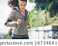 Fitness young woman jogging in the city park 16734641