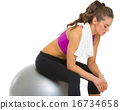 Tired fitness young woman sitting on fitness ball 16734658