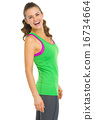 Portrait of smiling fitness young woman 16734664