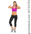 Full length portrait of happy fitness young woman showing thumbs 16734702