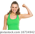 Smiling fitness young woman showing biceps 16734942