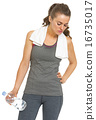 Tired fitness young woman with towel and bottle of water 16735017