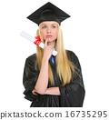 Thoughtful young woman in graduation gown with diploma 16735295