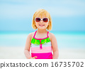 Portrait of happy baby girl in sunglasses on beach 16735702