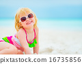 Portrait of happy baby girl in sunglasses on beach 16735856