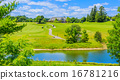 Golf place with pond and custom built luxury big house on background. 16781216