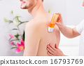 man receiving waxing for hair removal 16793769
