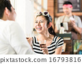 Asian couple in cafe flirting while drinking coffe 16793816