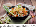 Fried rice with sliced sausage on wooden table. 16830775