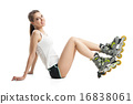 Pretty happy girl with rollerskates sitting on floor against white background 16838061