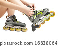 Woman lacing up rollers  16838064