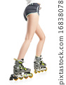 Close up  picture of woman's legs with rollerskates  16838078