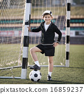 boy plays football on stadium 16859237