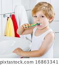 Lovely toddler boy brushing his teeth, indoors 16863341