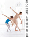 The little ballerina posing at ballet barre with personal teacher in dance studio 16867040