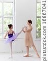 The little ballerina posing at ballet barre with personal teacher in dance studio 16867041