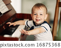 little happy boy plays piano 16875368