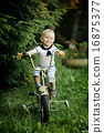 little happy boy on bike 16875377