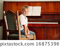 little happy boy plays piano 16875396