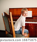 little happy boy plays piano 16875875