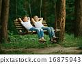 little boys dreaming on swing 16875943