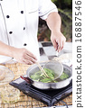 Chef scald vegetable in pot before cooking noodle 16887546