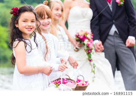 Stock Photo: Wedding bridesmaids children with flower basket