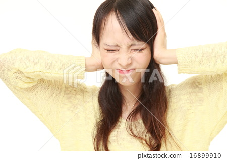 A woman clogging the ear 16899910