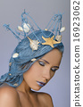 attractive woman with blue hair, crown and shells 16923062