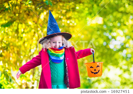 Stock Photo: Little girl in witch costume at Halloween