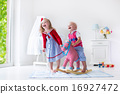 Kids playing with rocking horse 16927472