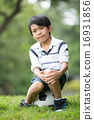 Little asian boy with football at the park 16931856