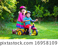 Two children riding bikes 16958109