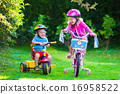Two children riding bikes 16958522