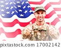 Composite image of soldier showing thumbs up 17002142