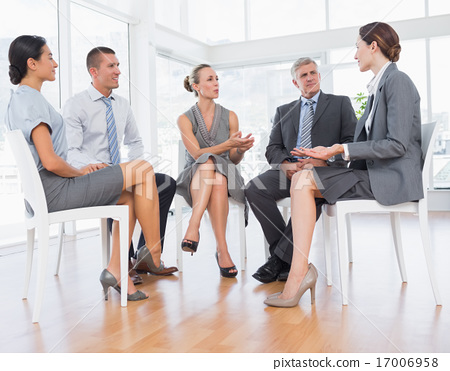 Stock Photo: Business team sitting in circle and discussing