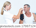 Doctor examining a man wrist 17007124